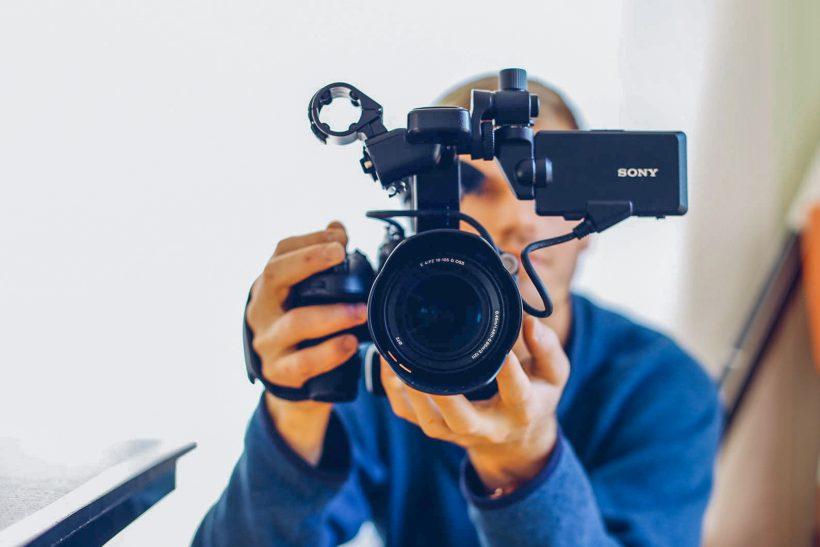 Charity film maker holds camera