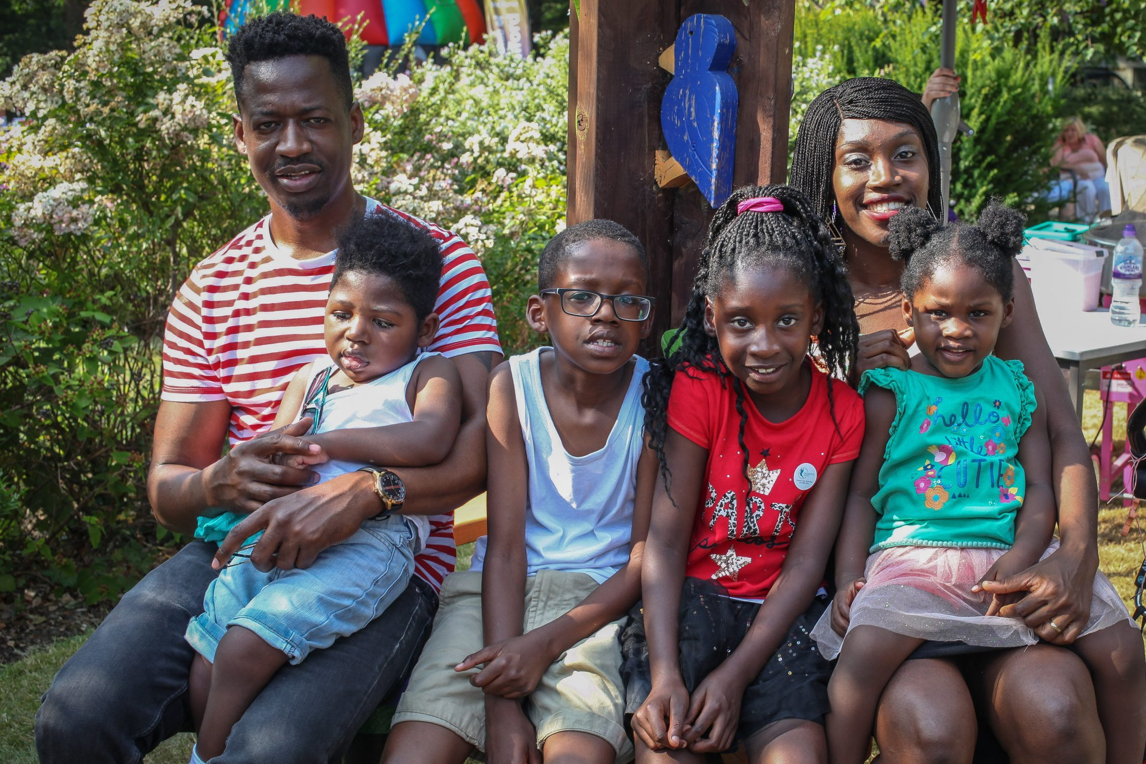 smiling family in charity photograph