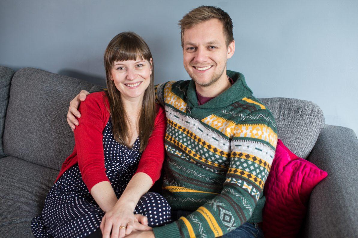 good looking couple on sofa